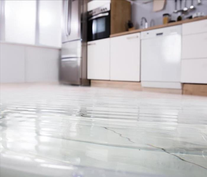 Flooded water on a kitchen floor
